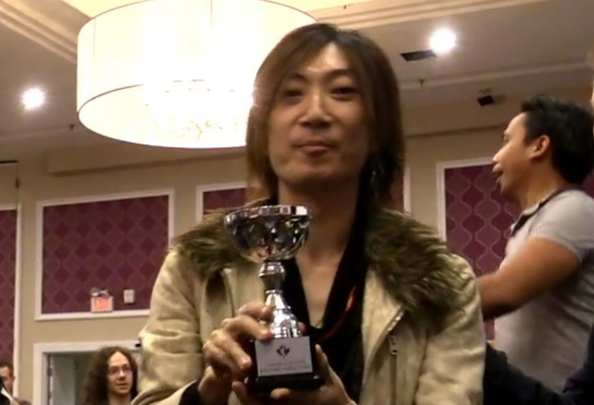 Mattsun holding the championship trophy for winning Canada Cup